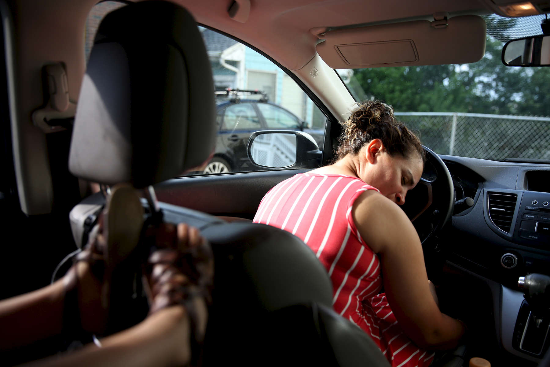 Revere, MA--7/27/2018--  After a full day of work, Patricia rested her head on the steering wheel for a moment after picking up Camila from the babysitter. Since the TPS decision has come down Patricia has been plagued by questions and what-ifs. Will immigration agents kick in her front door and drag her out in handcuffs? Will they come get her at work? If they do, what about her daughter? Who would care for her? Here in the US she has a life. Here, she is free. Here, she is home. But for how long?