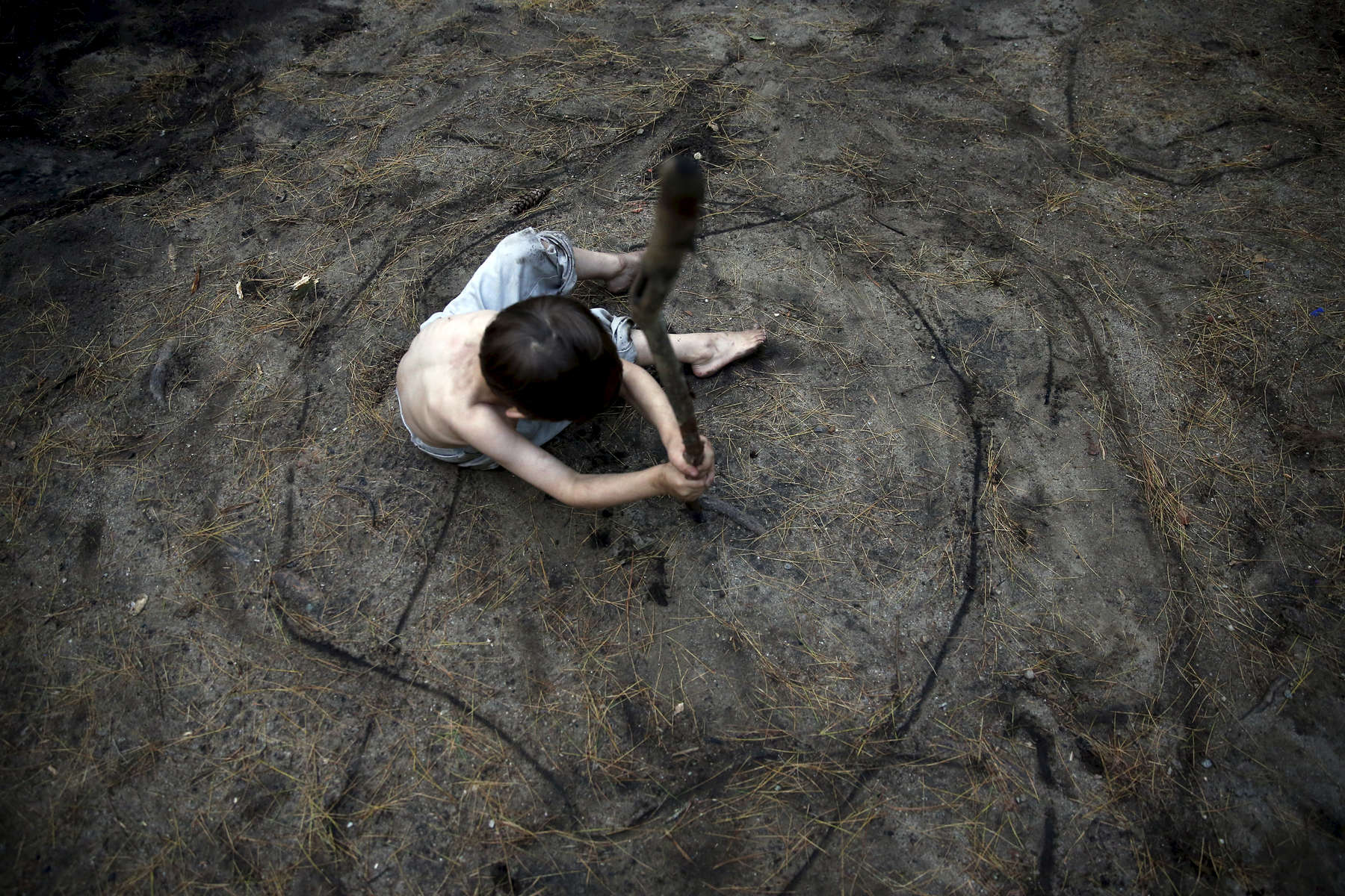Oxford, Maine -- 6/10/2015--  Gallagher sat in the center of a circle his brother, Strider, had etched around him in the dirt. Jessica Rinaldi/Globe Staff
