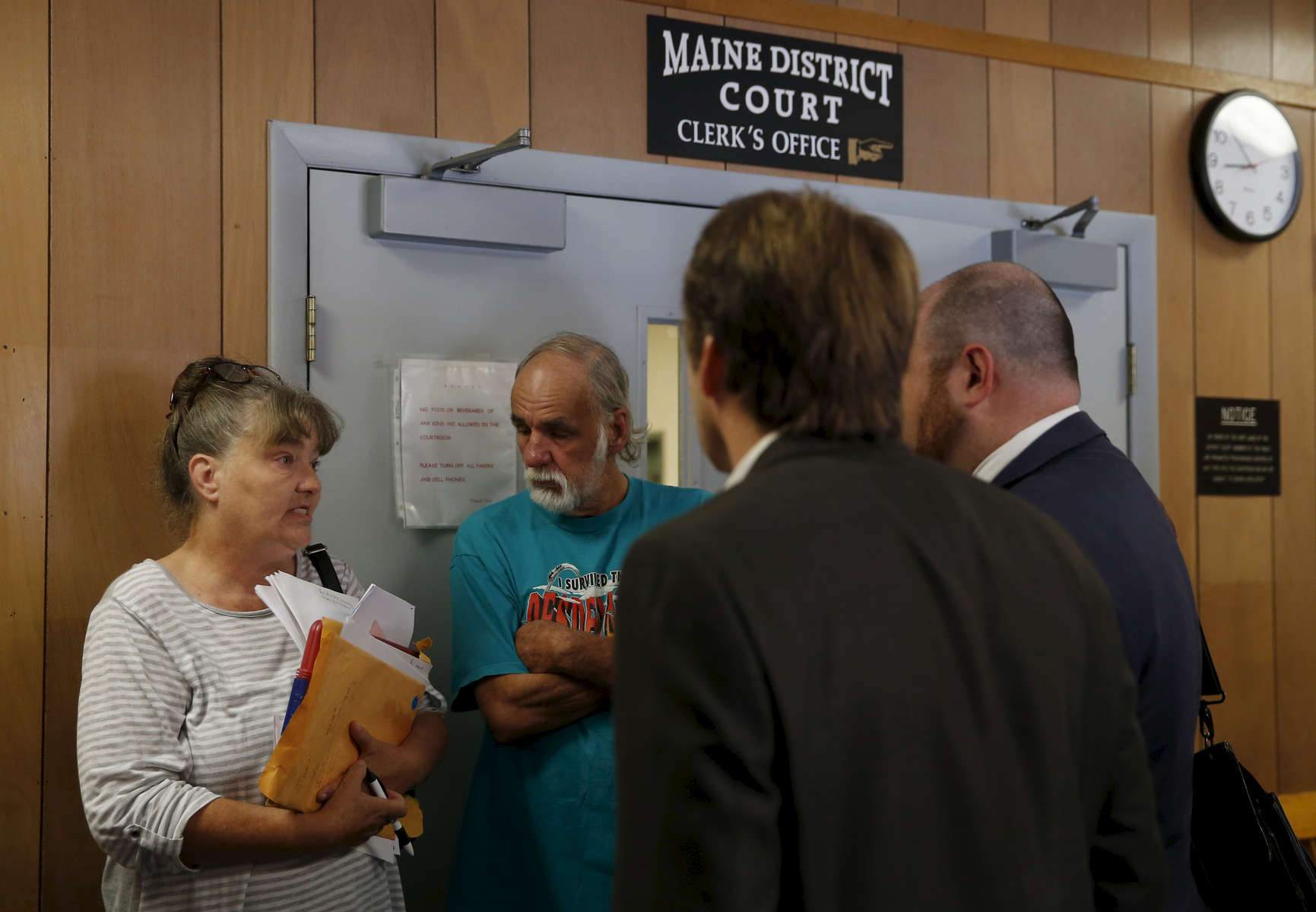 South Paris, Maine -- 7/21/2015-- Without a lawyer they were left without much hope of winning against their old landlord (2nd from L). Lanette and Larry went into the hallway after the judge asked if they might be able to come to an agreement. Things were complicated, the landlord had already sold the land to someone else and the new owner eventually agreed to box up some of the family photos left behind and leave them at the police station for the Grants to retrieve. Jessica Rinaldi/Globe Staff