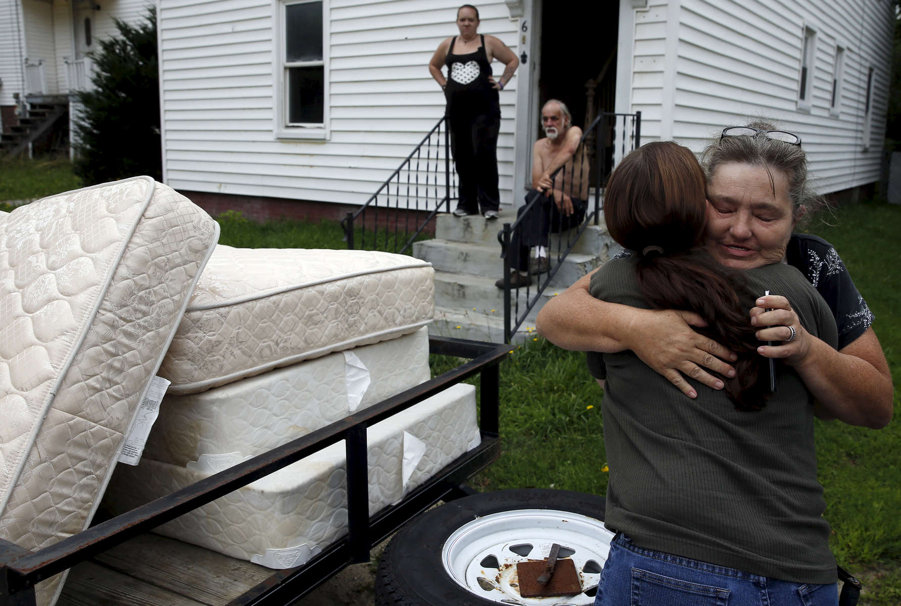 Lisbon, Maine -- 8/9/2015-- After months of searching for a new place to live a craigslist post had finally turned up a home they could afford. Anna Cunningham, of Skowhegan, arrived to the family's new home with a delivery of beds for the boys and couches and chairs for the family and Lanette grabbed her and pulled her in for a grateful hug.