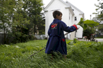 Lisbon, Maine -- 8/11/2015-- After waking up in his new home and pulling on a newly donated bathrobe, Strider affixed a giant leaf to the end of a stick and played in the backyard. Jessica Rinaldi/Globe Staff