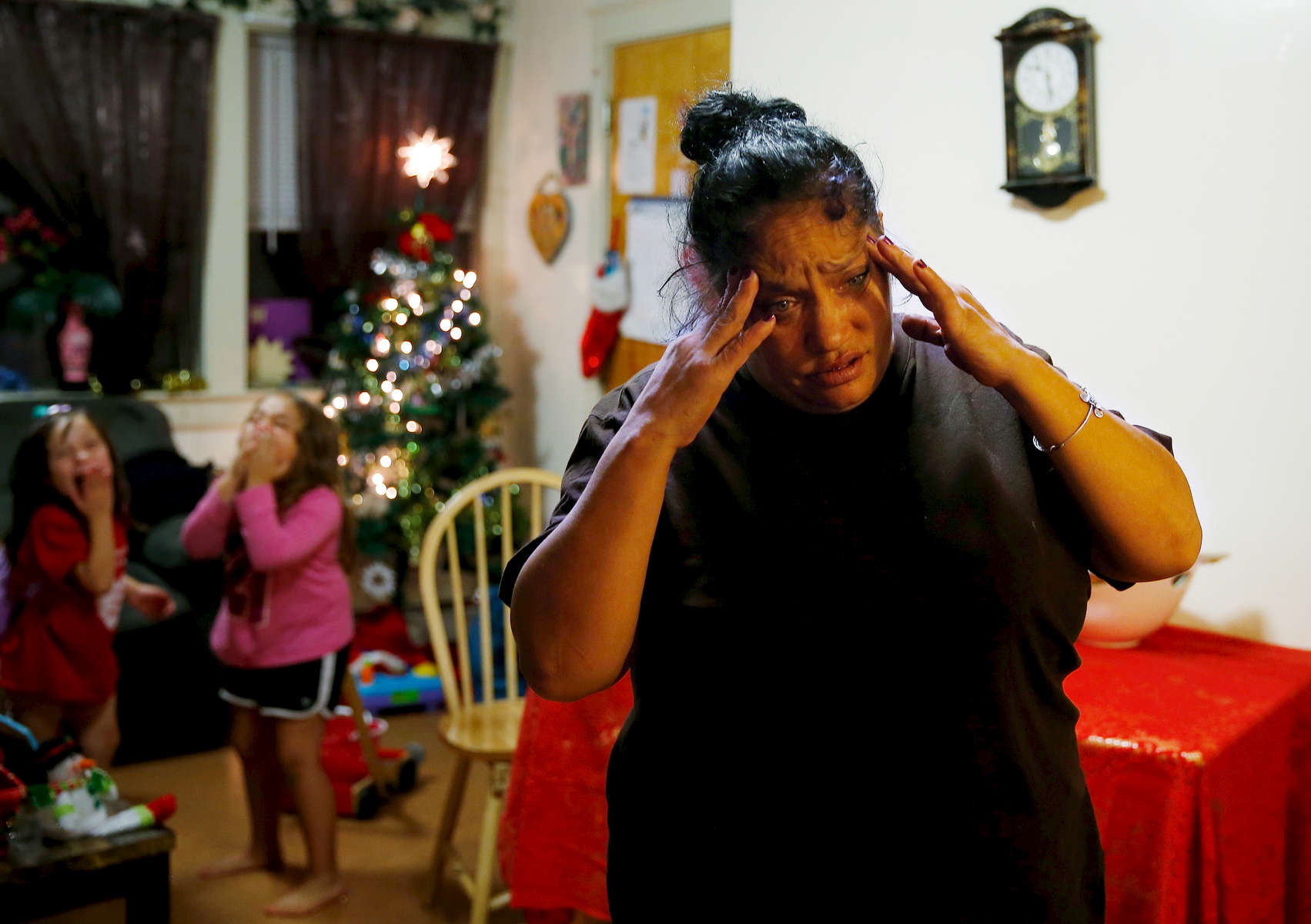 High on heroin, Raquel Rodriguez reacts as her daughters, Estrella and Mimi, run back and forth across her small living room. Tomorrow Raquel will go to the clinic and get her first dose of methadone, but tonight she worries that she won't be able to do it.