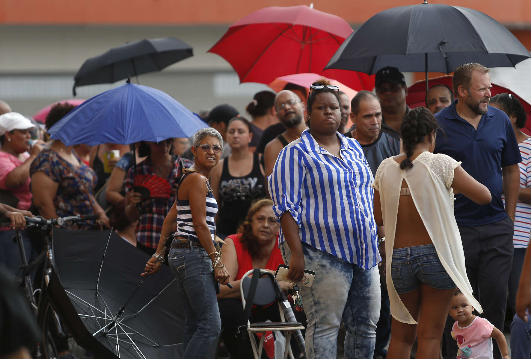Caguas, PR -- 9/29/2017 -  By 9am more than 500 people were waiting in line to use the ATM outside of Banco Popular in Caguas. Without power, cash was the only option for purchasing the scarce supplies that were available to local residents. Long lines were everywhere in cities like Caguas, some lasting for days for essentials like fuel, food, water, and even laundry.