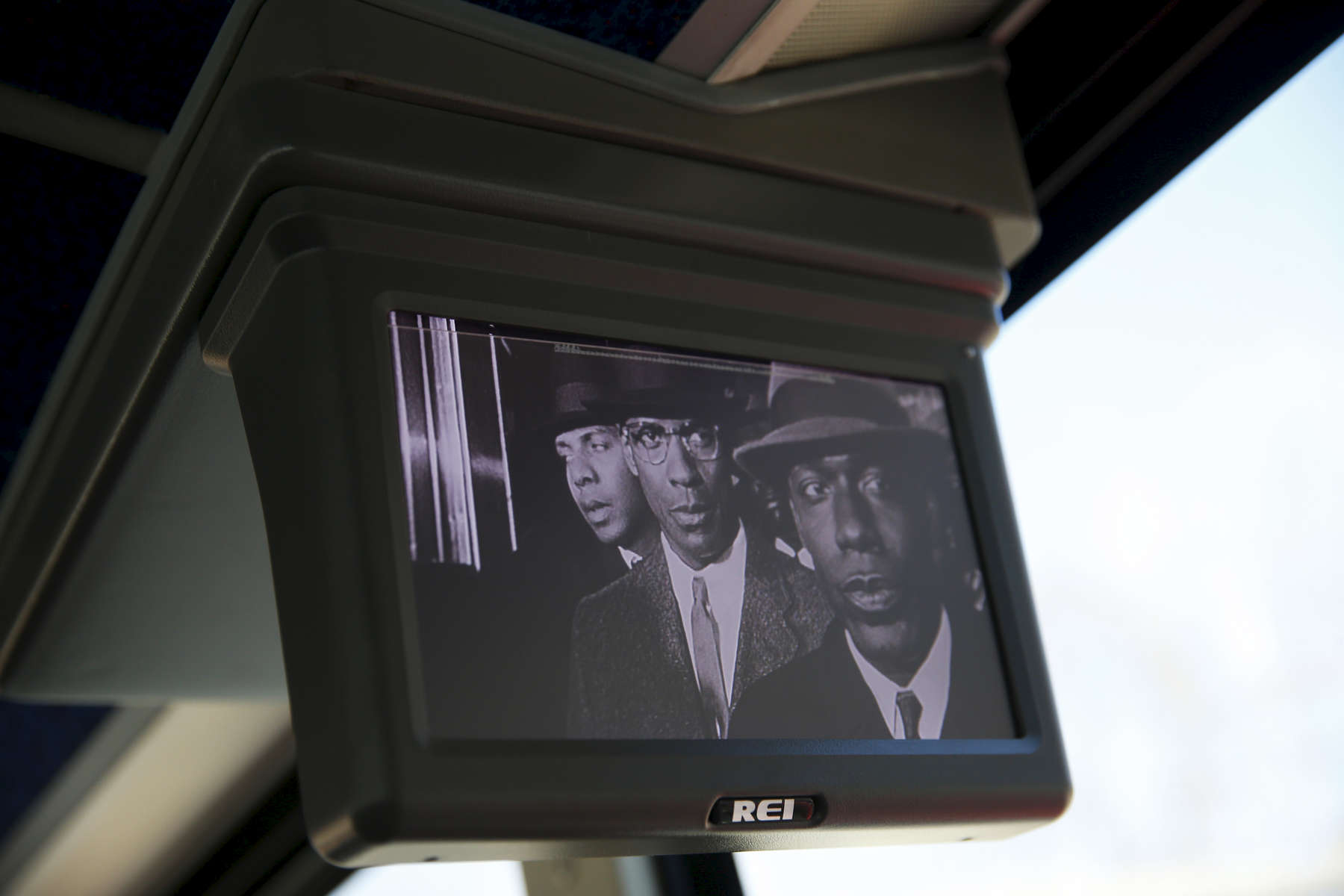 Journey To Selma -- 3/06/2015-- A scene from the movie Malcolm X is seen on one of the tv screens on the journey to Selma, Alabama March 6, 2015. Jessica Rinaldi/Globe StaffTopic: Reporter: