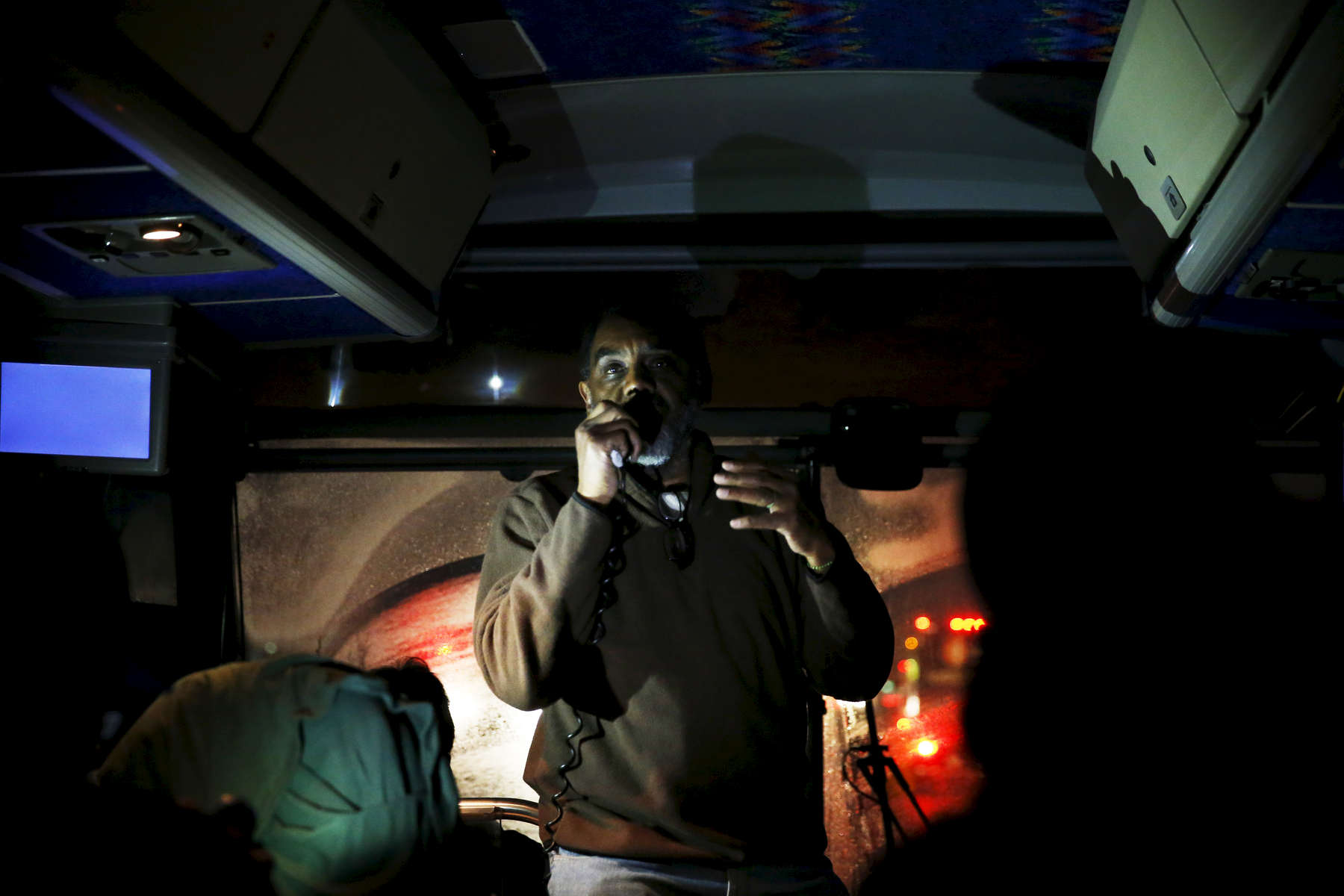 Journey To Selma -- 3/06/2015--At 2:13 am UMass Professor Tony Van Der Meer leads a spirited discussion after students watched Selma as they make the 25 hour journey by bus to Selma, Alabama March 6, 2015. Jessica Rinaldi/Globe StaffTopic: Reporter: