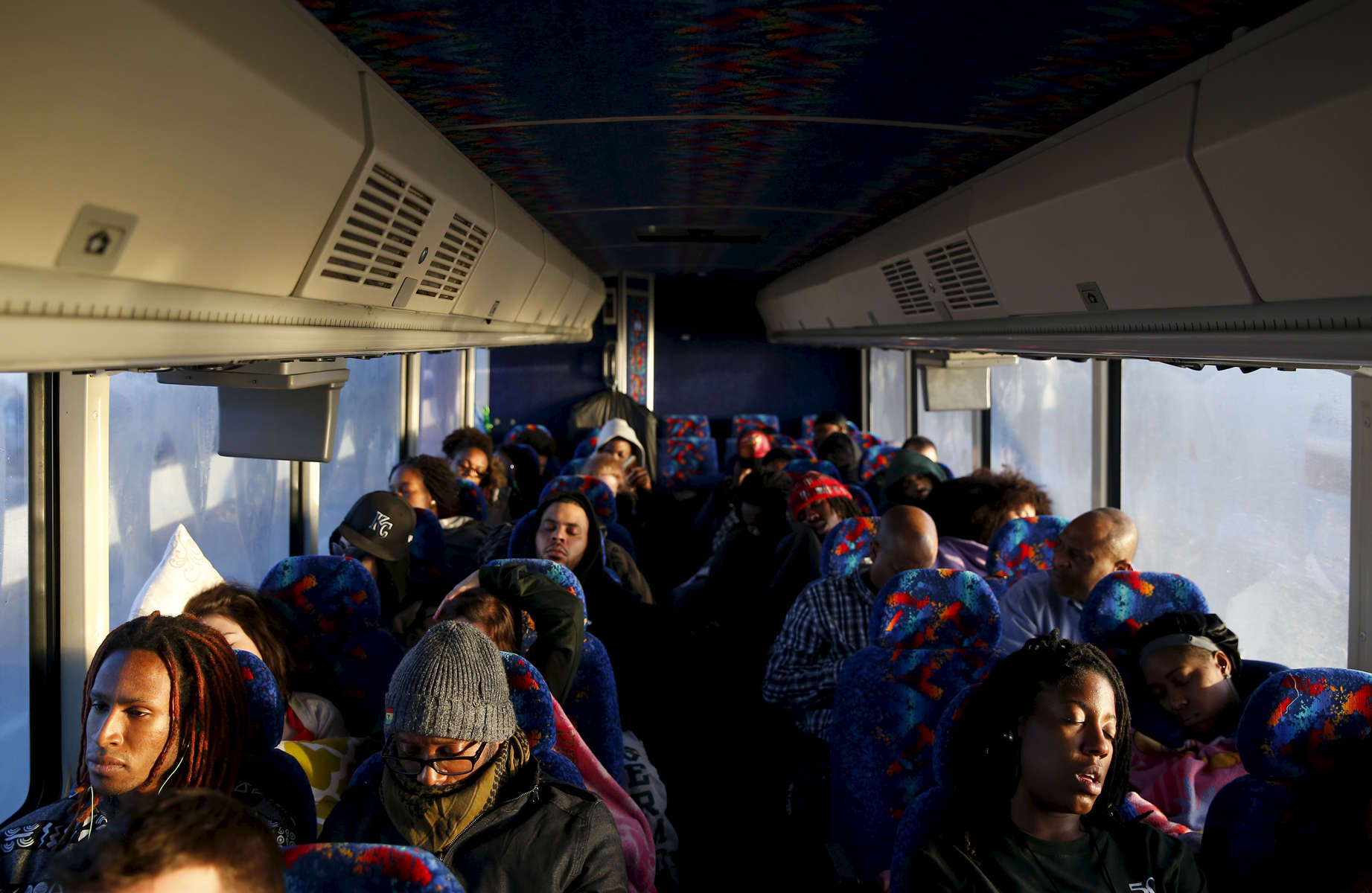 Journey To Selma -- 3/06/2015-- Students rest as the sun comes up during their journey to Selma, Alabama March 6, 2015. Jessica Rinaldi/Globe StaffTopic: Reporter: