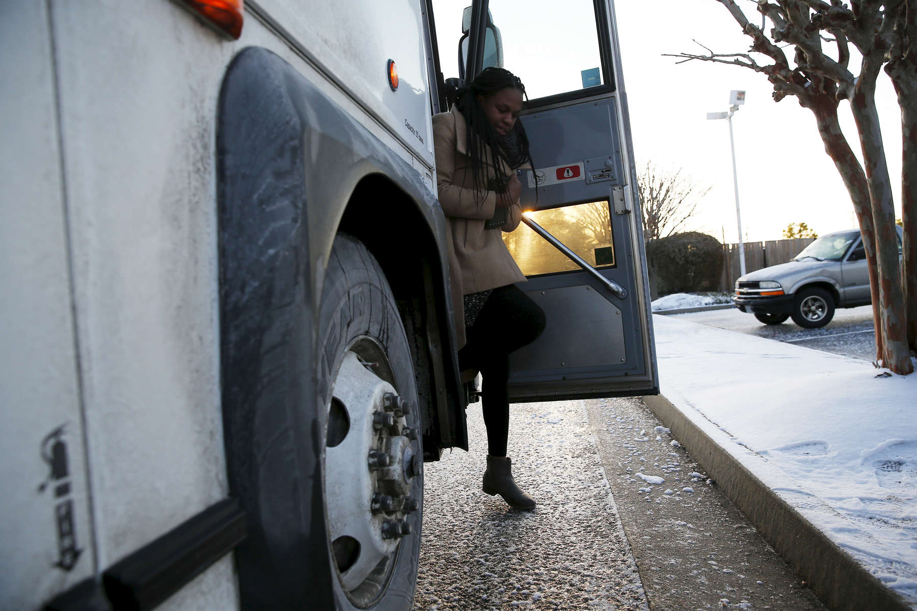 Journey To Selma -- 3/06/2015-- A student steps off of the bus onto icy pavement near Richmond, Virginia during a pitstop on the journey to Selma, Alabama March 6, 2015. Jessica Rinaldi/Globe StaffTopic: Reporter:
