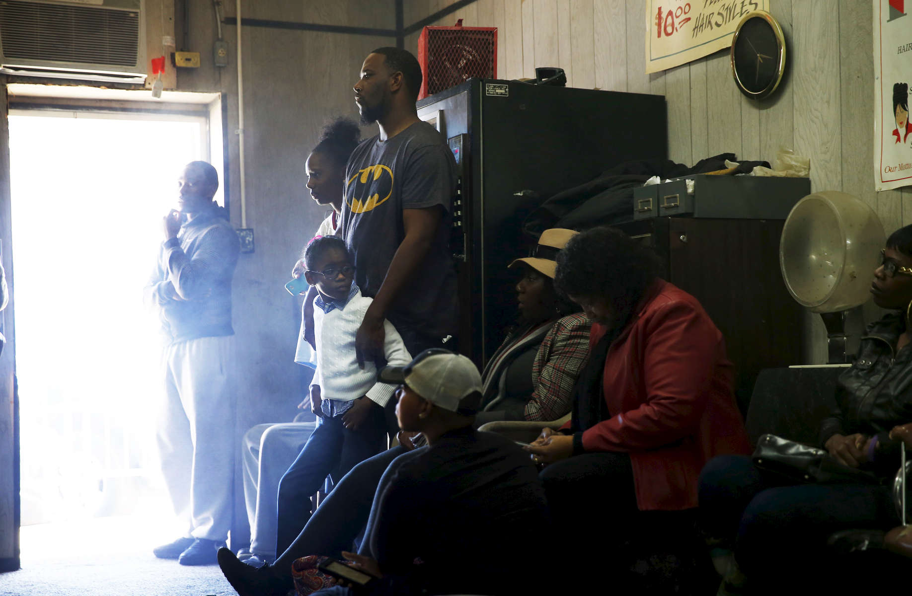 Selma, Alabama -- 3/07/2015-- People watch President Obama deliver a speech on a television set inside at Ray\'s Bar-B-Que Sandwich Shop which also doubles as a barber shop in Selma, Alabama March 7, 2015. Jessica Rinaldi/Globe StaffTopic: Reporter: