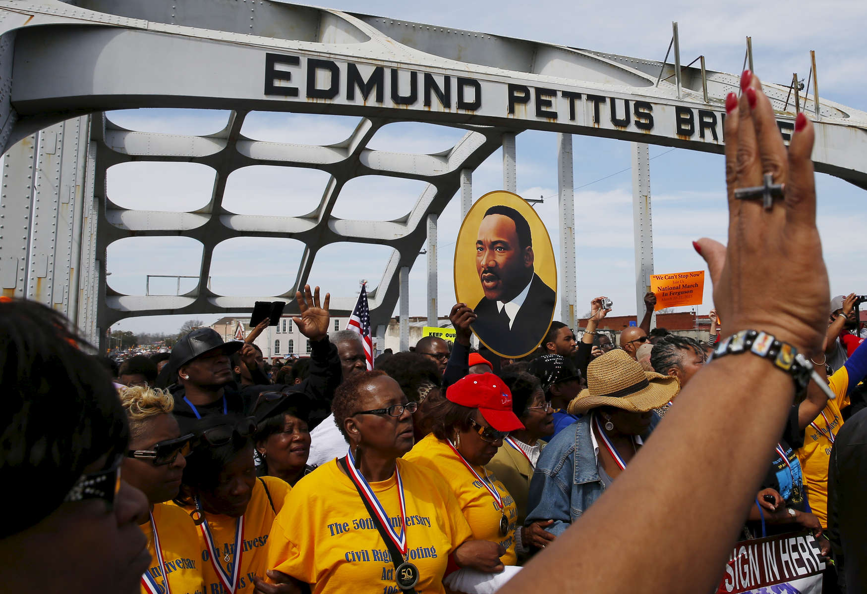 Selma, Alabama -- 3/08/2015-- Marchers retrace the steps of those who marched with Dr. Martin Luther King, Jr. over the Edmund Pettus Bridge in Selma, Alabama March 8, 2015. Jessica Rinaldi/Globe StaffTopic: 09selmaReporter: