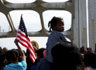 Selma, Alabama -- 3/08/2015-- A girl looks back as she is carried across the Edmund Pettus Bridge as she and thousands of others retrace the steps of those who marched with Dr. Martin Luther King, Jr.  in Selma, Alabama March 8, 2015. Jessica Rinaldi/Globe StaffTopic: 09selmaReporter: