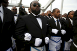 Selma, Alabama -- 3/08/2015-- Members of the Most Worshipful Prince Hall Grand Lodge link arms as they retrace the steps of those who marched with Dr. Martin Luther King, Jr. over the Edmund Pettus Bridge 50 years ago in Selma, Alabama March 8, 2015. Jessica Rinaldi/Globe StaffTopic: 09selmaReporter: