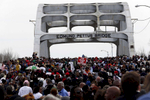 Selma, Alabama -- 3/08/2015-- Marchers retrace the steps of those who marched with Dr. Martin Luther King, Jr. 50 years ago over the Edmund Pettus Bridge in Selma, Alabama March 8, 2015. Jessica Rinaldi/Globe StaffTopic: 09selmaReporter: