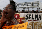 Selma, Alabama -- 3/08/2015-- A marcher sings while they retrace the steps of those who marched with Dr. Martin Luther King, Jr. over the Edmund Pettus Bridge in Selma, Alabama March 8, 2015. Jessica Rinaldi/Globe StaffTopic: 09selmaReporter: