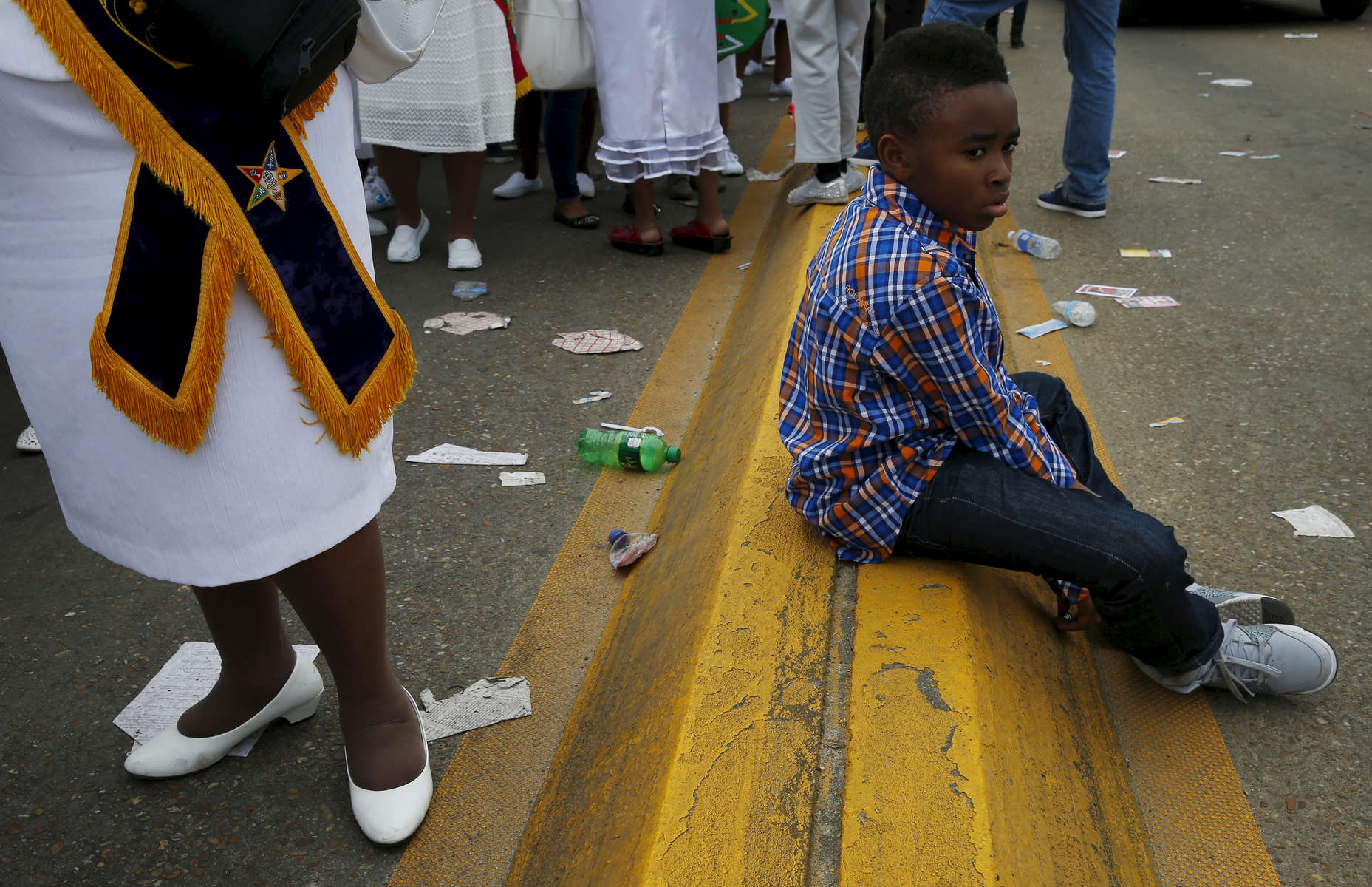 Selma, Alabama -- 3/08/2015-- A boy sits on the dividing line of the Edmund Pettus Bridge as marchers retrace the steps of those who marched with Dr. Martin Luther King, Jr. 50 years ago in Selma, Alabama March 8, 2015. Jessica Rinaldi/Globe StaffTopic: 09selmaReporter: