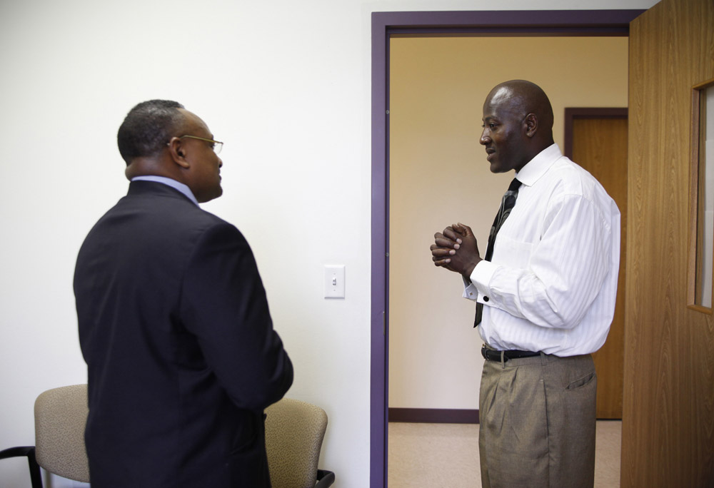 Frederick Wilson (R) clasps his hands as he speaks with human resources director of Paramount Multiservices Ervin Powers II (L) at the conclusion of a job interview held in the offices of the Urban League of Greater Dallas in Dallas, Texas June 30, 2009.