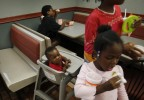 (L-R) Wilson family members Javonte Miles, 10, Keziah Bradley, Kayla Miles, 12, and Dorche Woods, 4, eat dinner at a fast food restaurant in Grand Prairie, Texas June 30, 2009.