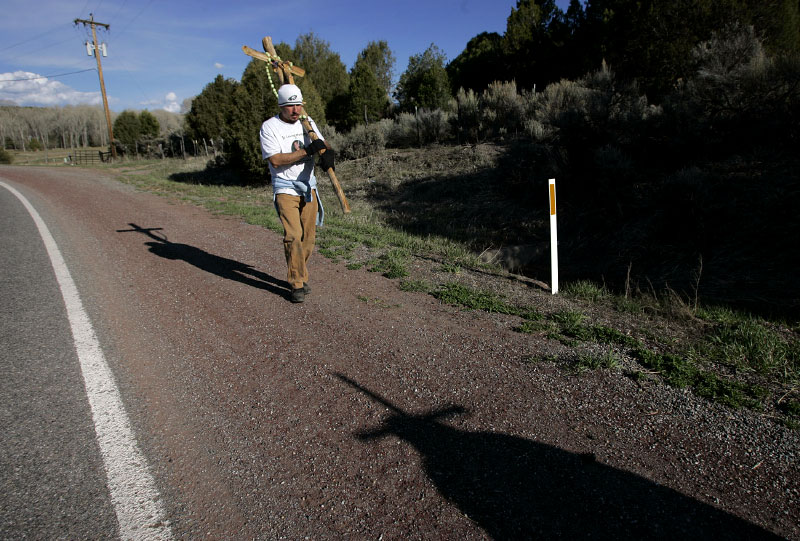 Pilgrims carry crosses along the side of the high road that leads to El Santuario de Chimayo in Chimayo, New Mexico April 8, 2007.