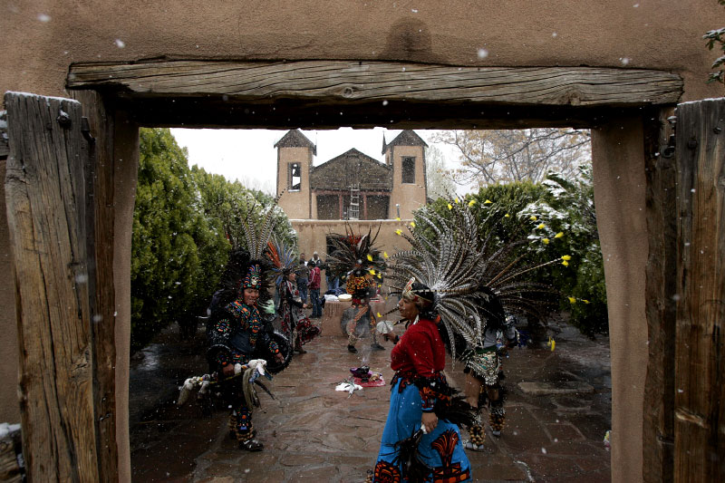 Aztec dancers from Taos, New Mexico perform in front of the entrance to El Santuario de Chimayo in Chimayo, New Mexico April 7, 2007.