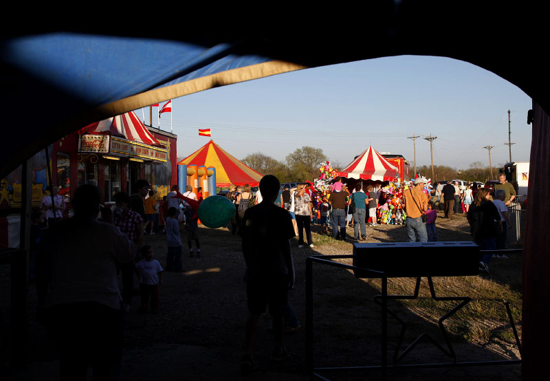 People walk through the grounds at the Kelly Miller Circus in Crandall, Texas March 18, 2009.