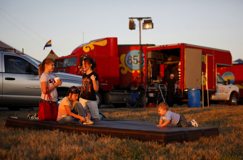 Children play on a tumbling mat outside of one of the performer's trailers at the Kelly Miller Circus in Crandall, Texas March 18, 2009.