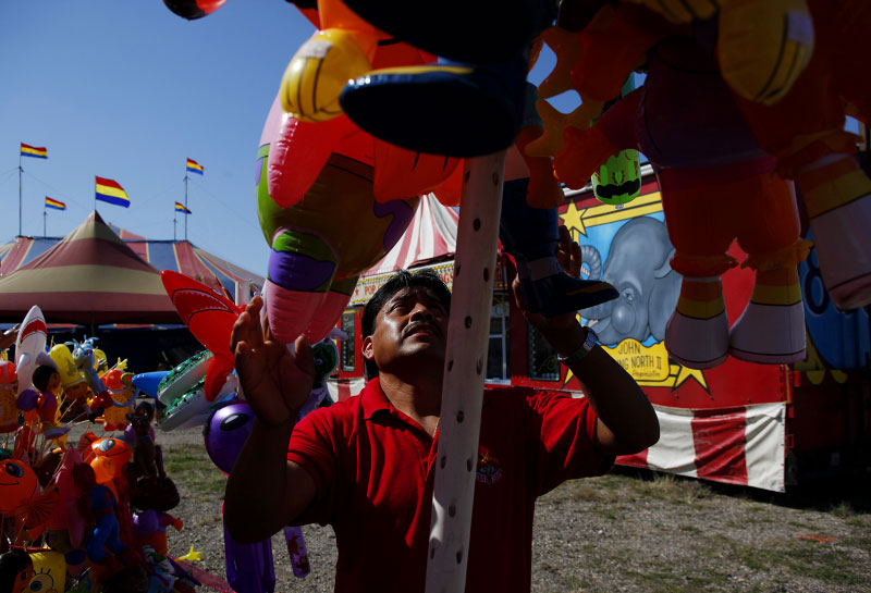 Jose Luis Soto sets up the balloon stand at the Kelly Miller Circus in Crandall, Texas March 18, 2009.