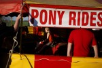 Kids take advantage of pony rides at the Kelly Miller Circus in Crandall, Texas March 18, 2009.