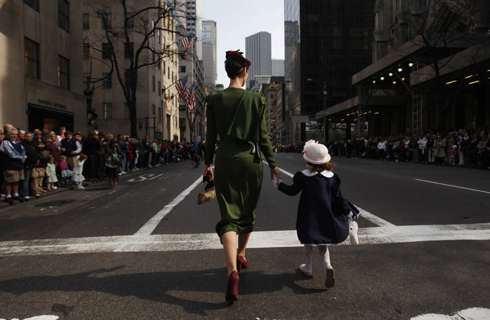 Joie Gregory and her daughter Catherine, 4, (R) walk down the street at the Easter Bonnet Parade in New York April 4, 2010.