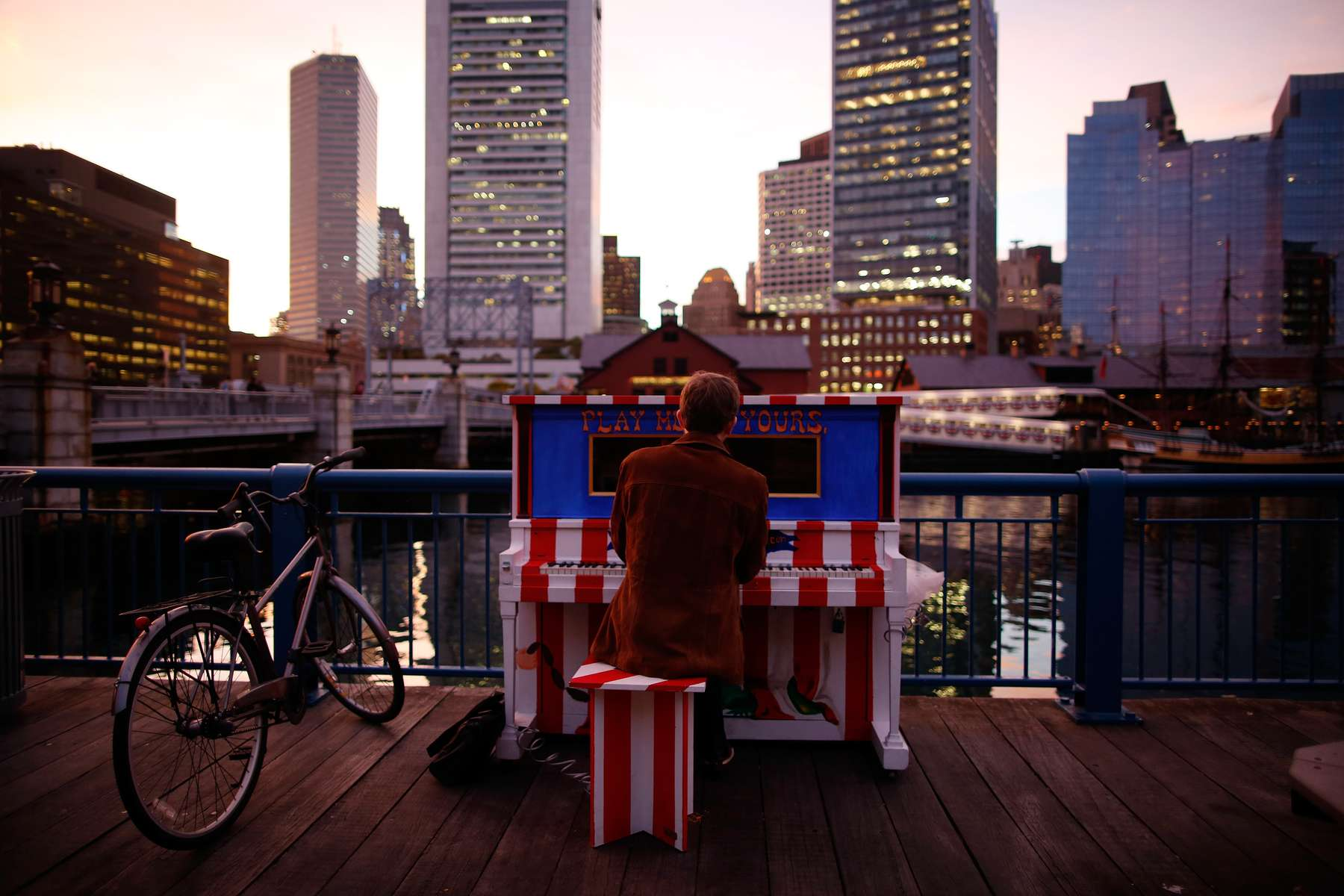 Martin Rohrmeier, of Germany plays on a street piano across from the Boston Tea Party during the last day of Celebrity Series of Boston {quote}Play Me, I'm Yours{quote} in Boston, Massachusetts October 14, 2013.