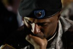 Tears stream down US Army Sgt Major Leroy Walker Jr.'s face during a candle light vigil at Hood Stadium on the Fort Hood Army Post in Fort Hood, Texas November 6, 2009.
