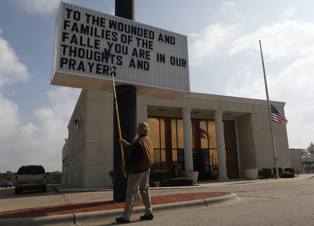 Ken Thomas arranges a message to the wounded and the families of the victims of the Fort Hood shootings on a sign in Killeen, Texas November 9, 2009. Thirteen people died in the mass shooting Thursday at the sprawling U.S. Army base in Texas. An Army psychiatrist trained to treat war wounded is suspected in the killings. The suspect, Major Nidal Malik Hasan, a Muslim born in the United States of immigrant parents, was shot four times by police.