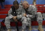 Lt. Col. Houck and  Army Warrant Officer Carlton Royster, 30, of Philadelphia, pray together during a farewell event for the III Corps Special Troops Battalion on the verge of deploying to Iraq. It was the first deployment to take place after the shootings at Fort Hood.