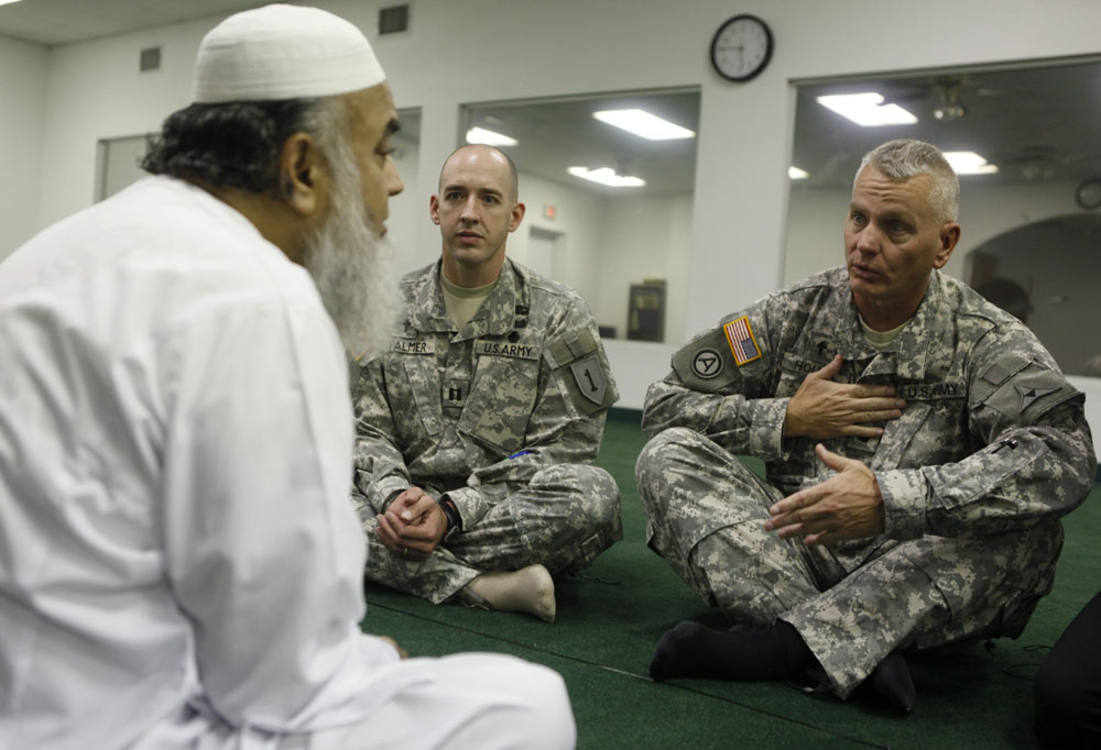(L-R) Imam Syed Ahmed Ali, Chaplain Jason Palmer, and Chaplain Ira Houck talk at the Islamic Community Center in Killeen, Texas November 7, 2009. The Chaplains paid a visit to the Imam to extend an invitation to the memorial service being held on Tuesday, for victims of a mass shooting. Major Nidal Malik Hasan, the Army psychiatrist who is suspected of killing 13 people during the mass shooting at the Fort Hood Army post, attended prayer services at the Islamic Community Center.
