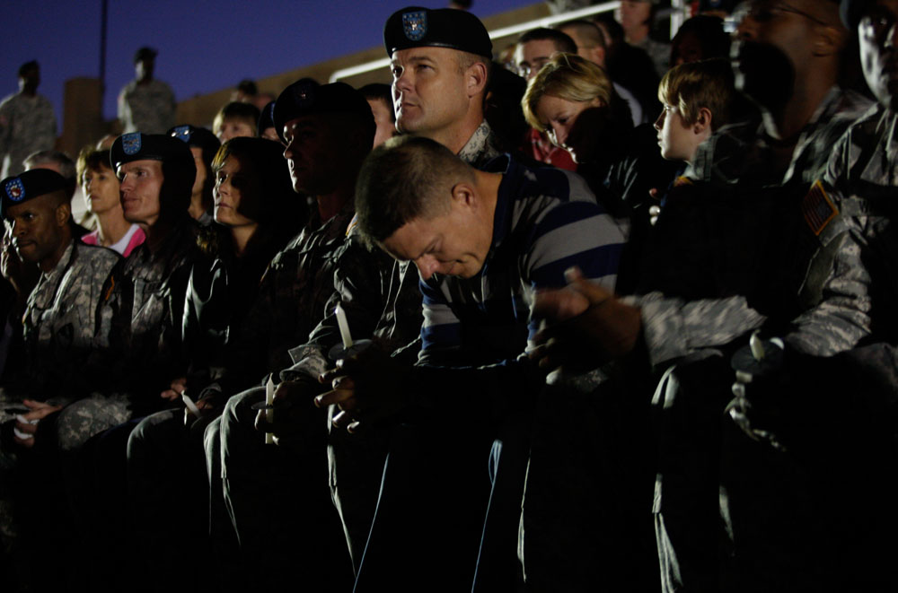 U.S. soldiers attend a candle light vigil at Hood Stadium on the Fort Hood Army Post in Fort Hood, Texas November 6, 2009. The death toll left by an army psychiatrist who went on a shooting rampage at the U.S. military base in Texas rose to 13 on Friday, U.S. media reported. Suspected gunman Major Nidal Malik Hasan opened fire with two handguns at the Fort Hood Army post on Thursday, in one of the worst killing sprees ever reported on a U.S. military base, army officials said.