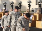 U.S. Army soldiers pay their respects in front of fallen soldier memorials for the shooting victims during the III Corps and Fort Hood Memorial Ceremony at Fort Hood, Texas, November 10, 2009.