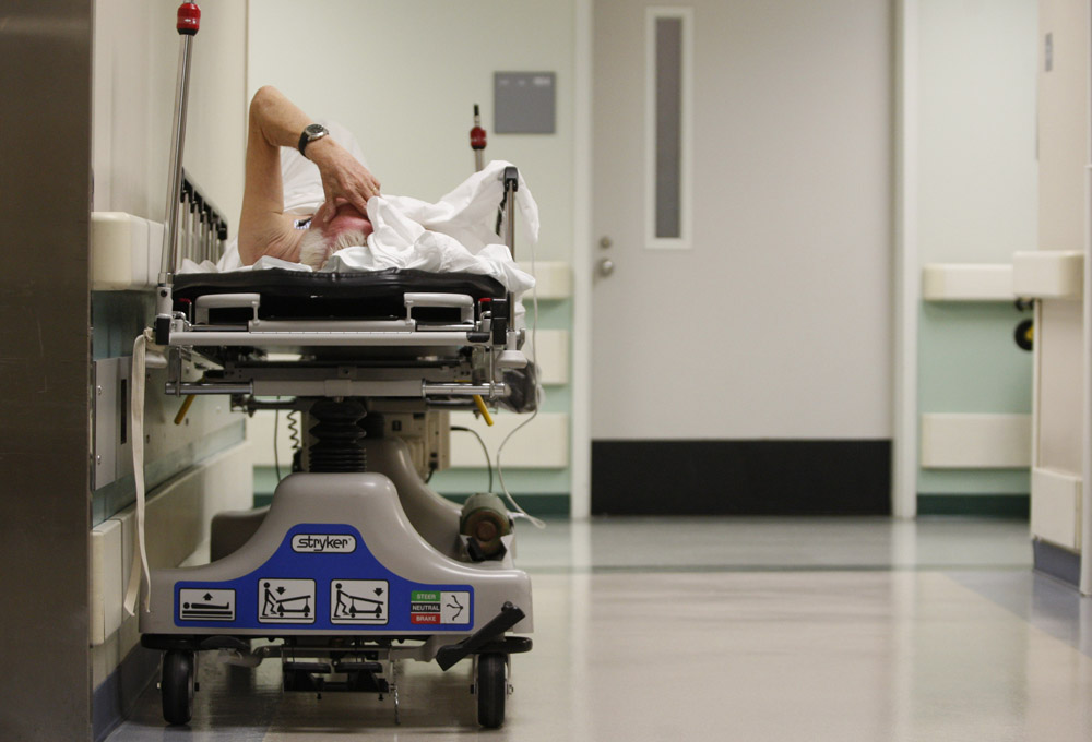A patient waits in the hallway for a room to open up in the emergency room at Ben Taub General Hospital in Houston, Texas, July 27, 2009. Houston, the fourth-largest American city, is a case study in the extremes of the U.S. healthcare system. It boasts the immense medical center that offers top-notch care at its 13 hospitals, but also has a higher ratio of uninsured patients than any major U.S. city: about 30 percent.