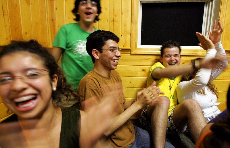 Undocumented worker Mario Rodas laughs with his friends during a Student Immigration Movement retreat in Sudbury, Massachusetts June 17, 2006.