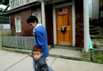 Undocumented worker Mario Rodas walks his four-year-old brother Kevin, who is a legal US citizen, home from daycare in Chelsea, Massachusetts June 2, 2006.