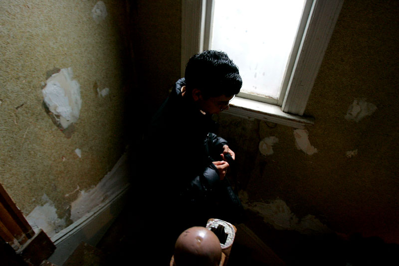 Undocumented worker Mario Rodas, 19 , walks down the front steps of his apartment in Chelsea, Massachusetts June 7, 2006. Rodas was picked up in a U.S. immigration sweep and now faces deportation from the United States back to his native Guatamala.