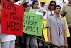 Undocumented worker Mario Rodas, 19, (R) stands among friends and supporters at a {quote}Rally to Keep Mario Home{quote} in Boston, Massachusetts, June 26, 2006.