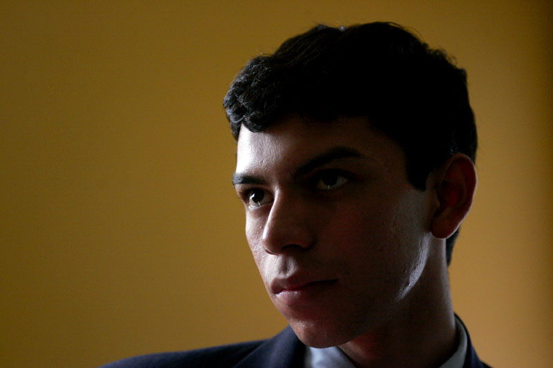 Undocumented worker Mario Rodas, 19, talks to friends in Everett, Massachusetts after his deportation hearing June 27, 2006.