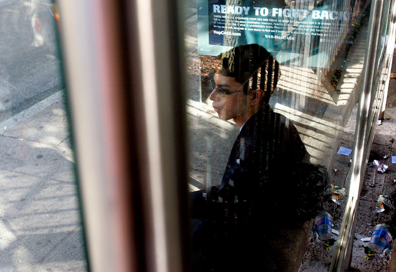 Undocumented worker Mario Rodas, 19, waits for the bus en route to his deportation hearing in Chelsea, Massachusetts, June 27, 2006.