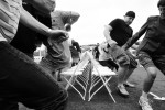 Contestants race to find a chair as the music stops during the Musical Chairs World Championship in Amesbury, Massachusetts June 16, 2012.
