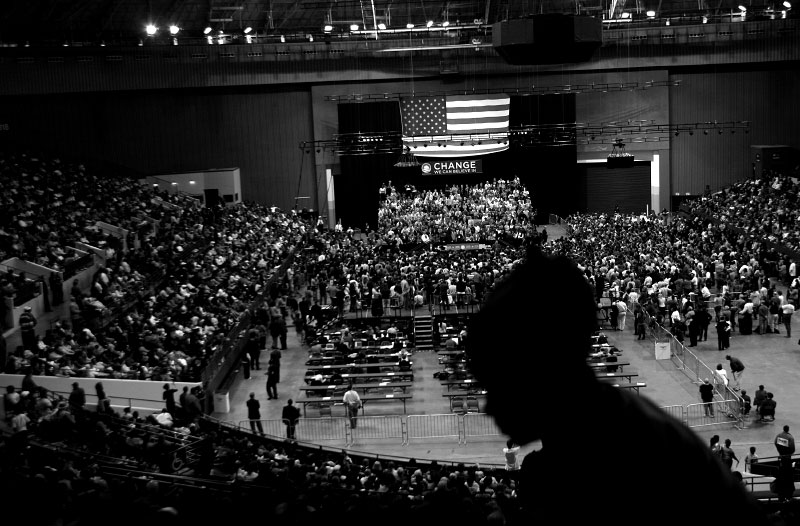 A woman takes her seat as US Democratic presidential candidate Senator Barack Obama (D-IL) speaks at a rally in Fort Worth, Texas February 28, 2008.