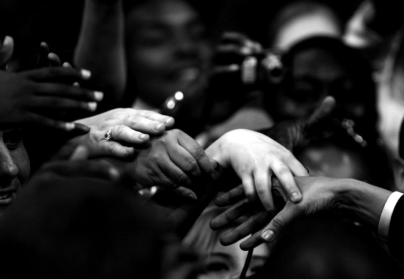 Supporters reach out to touch the hand of democratic presidential candidate Senator Barack Obama (D-IL) after he spoke at a rally in Dallas, Texas February 20, 2008