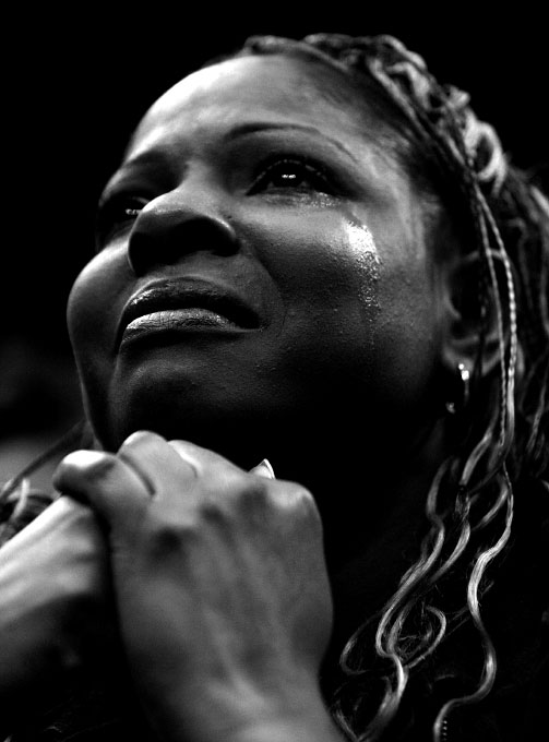 Chalonda Marcus of Forney, Texas cries as she listens to democratic presidential candidate Senator Barack Obama (D-IL) speaking at a rally in Dallas, Texas February 20, 2008.