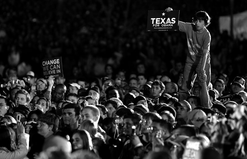 A boy stands above the crowd as democratic presidential candidate Senator Barack Obama (D-IL) speaks at a rally in San Marcos, Texas February 27, 2008.