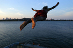 <p>South Boston, Massachusetts -- 07/08/2014--   Edson Pontes, of Dorchester leaps off of a pier into Old Harbor in South Boston, Massachusetts July 8, 2014. Jessica Rinaldi/Globe Staff</p><p>Topic: 09feature</p><p>Reporter: </p>