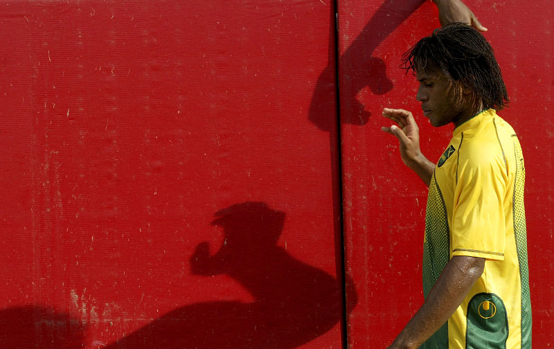 Jamaica's Jermaine Taylor walks back to the locker room after receiving a red card ejection for a tackle on the United States DaMarcus Beasley in the second half of their Concacaf Gold Cup match in Foxborough July 16, 2005.