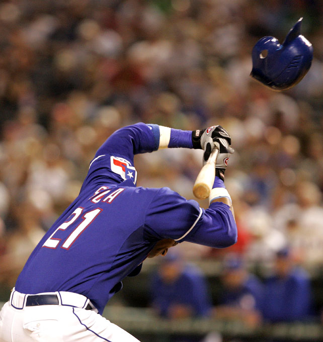 Texas Rangers Sammy Sosa's helmet flys off after he was hit in the head by a pitch from New York Yankees' pitcher Brian Bruney during the sixth inning of their MLB American League game in Arlington, Texas, May 3, 2007.