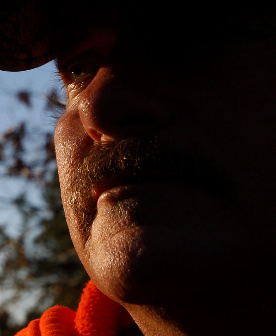 Trapper and Animal Control Officer Harold Renfro is lit by the rising sun after pulling his traps in Henderson, Texas December 7, 2008. Fur prices have collapsed as the U.S. economy sours, making it unprofitable for many trappers to ply their trade.